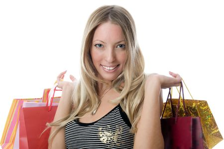Close-up of happy young woman on a shopping spree. Isolated on white background   photo