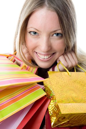 Close-up of happy young woman on a shopping spree. Isolated on white background   Stock Photo - 3279174