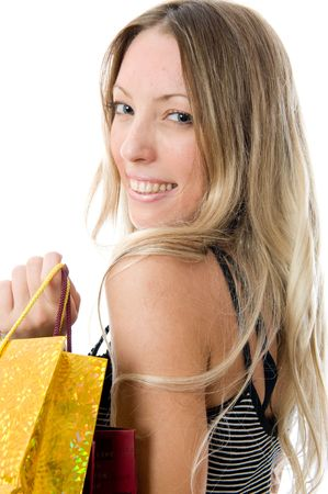 Close-up portrait. Happy young girl holding bags on a white background Stock Photo - 3279188