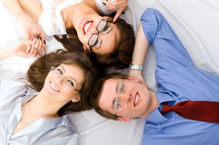 The young group of smiling business people lying on floor photo