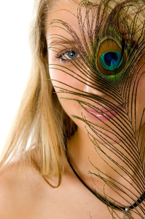 Close-up portrait of surprised girl with beautiful smile, peacock a feather closes eye  photo