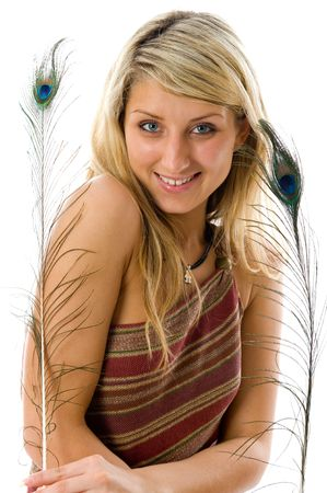 Portrait of beautiful girl with peacock a feather. Isolated over white background photo