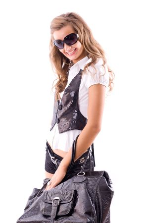 Attractive girl with big fashion bag. Isolated on white photo