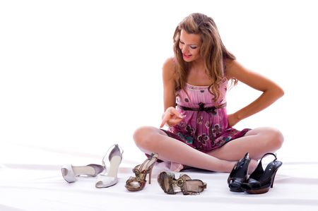 The choice of shoes is very difficultly. Isolated on white photo