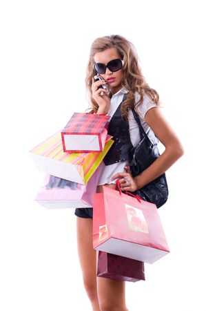 Close-up of happy young woman on a shopping spree. Talking by phone Isolated on white background Stock Photo - 3452968