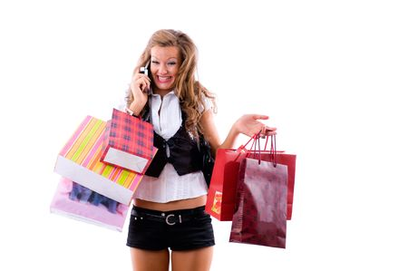 Close-up of happy young woman on a shopping spree. Talking by phone Isolated on white background photo