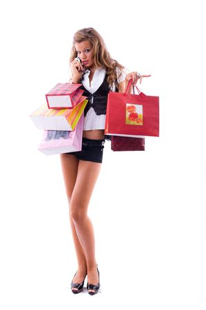 Close-up of happy young woman on a shopping spree. Talking by phone Isolated on white background Stock Photo - 3452948