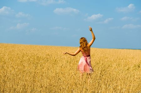Young girl walks on a field. Stock Photo - 3847679
