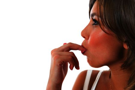 thinness: Attractive girl licks a finger over white background
