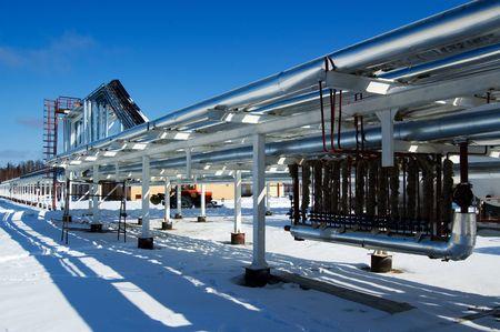 Industrial zone, Steel pipe-lines on blue sky