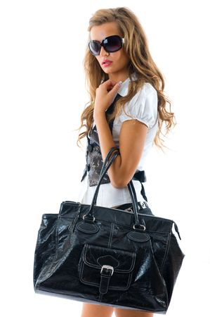 Fashion model with big bag. Isolated on white photo
