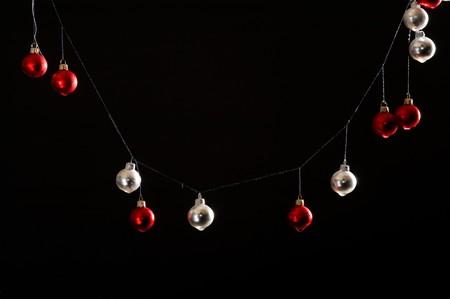 Christmas balls isolated on black background photo