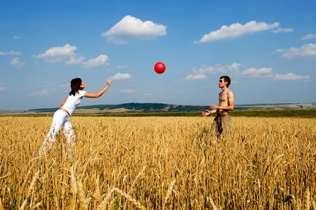 Red ball in game. The Young couple have fun Stock Photo - 3953092