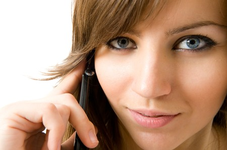 Closeup portrait of beautiful girl, talking on the phone 写真素材