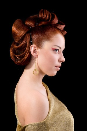 Professional hairstyle. Portrait of a cute model with beautiful hair.
