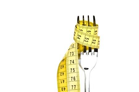 Diet concept. Metallic fork on white background photo