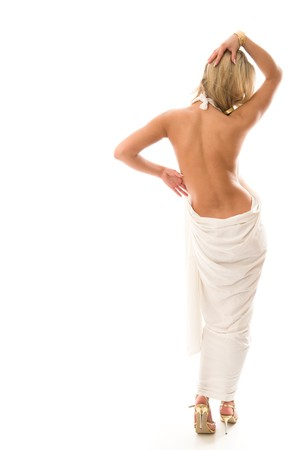 undressing woman: Sexy young woman standing with a bare back. Isolated over white background Stock Photo