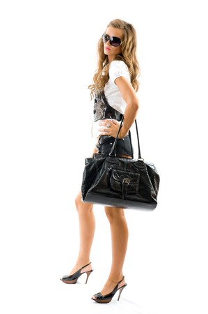 Fashion model with big bag. Isolated on white background 스톡 콘텐츠
