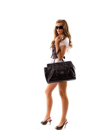 Fashion model with big bag. Isolated on white background photo