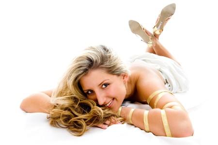 Beautiful smile. Girl lying on floor, isolated over white photo