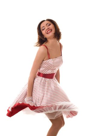 Dance. Fantastic positive girl in retro dress. Isolated over white