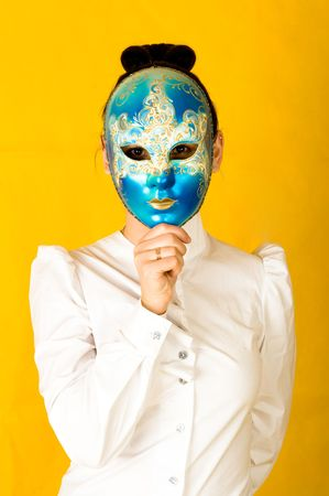 Portrait of young woman wearing mystical carnival mask photo