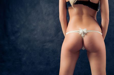 Pin-up image of girl bum on black background. Many lot of copyspace Stock Photo