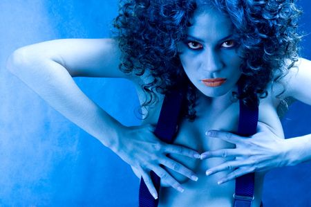 militant: The militant woman. Portrait of sexy girl in blue light