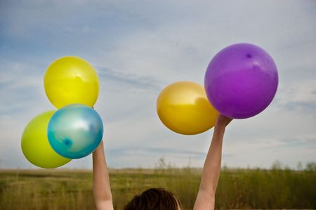 Hands holding balloon.  Stock Photo - 5286505