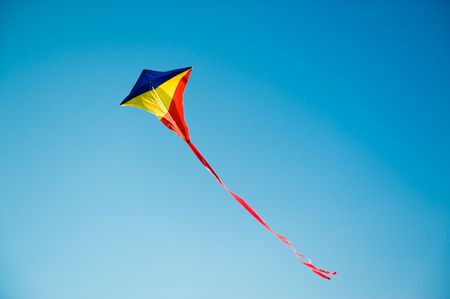 flying a kite: Flying kite in the blue sky Stock Photo