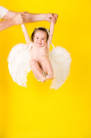 Fanny girl with angel wings on yellow Stock Photo - 5652022
