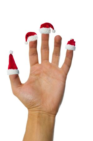 finer: Isolated hand holding up santas red hats on fingers