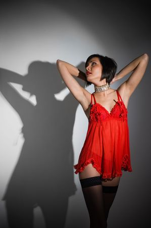Picture of sexy woman with red lingerie. Studio shot photo