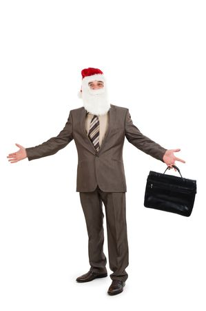 Businessman in suit with santa hat on head. Isolated over white background photo