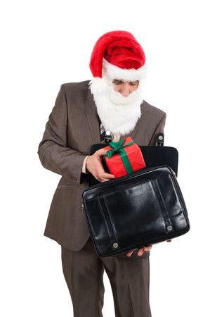 This gift for you. Businessman in suit with santa hat on head. Isolated over white background photo