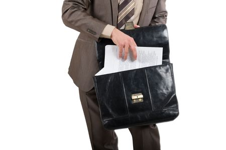 Contracts for the signature. Briefcase in hands of the businessman over white background photo