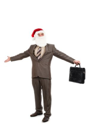 Businessman in suit with santa hat on head holding briefcase. Isolated over white background photo