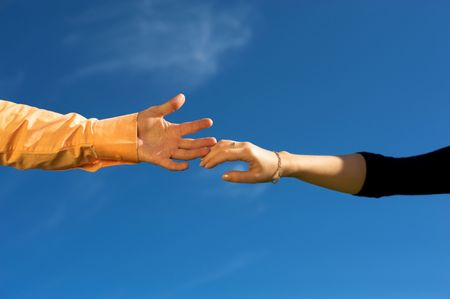 keep in touch: Couple hands in a sky close-up