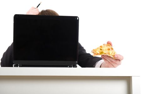 The businessman eats a pizza in the work, isolated over white photo