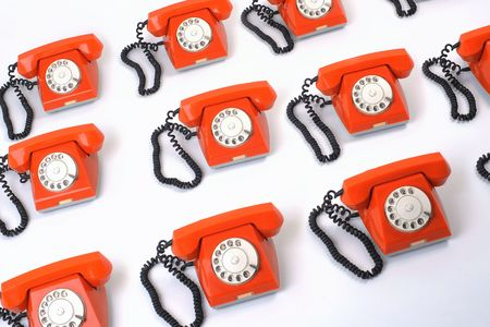 Close up large group of orange telephones
