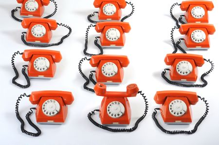 especial: Especial phone looks forward to hearing. Close up large group of orange telephones Stock Photo