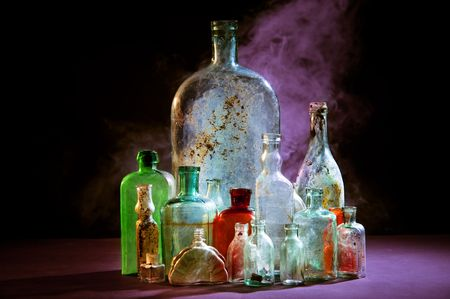 Magic bottles on dark Stock Photo - 7156005