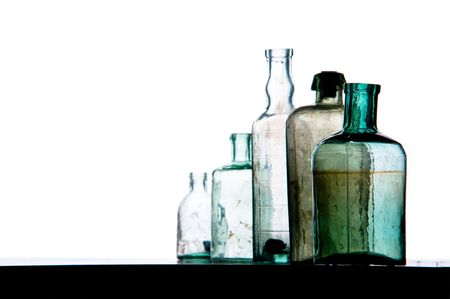 old bottles in a row on white Stock Photo