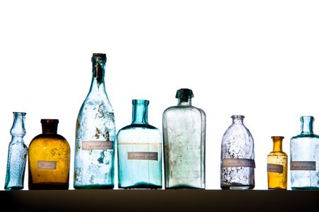 water stained: Empty magic bottles on white background