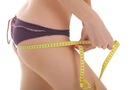 Measuring buttocks.   Closeup of a young female body Stock Photo - 6561166