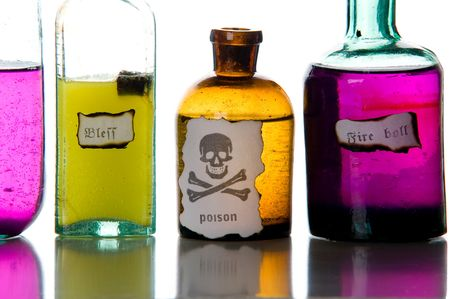 old container: Close-up magic spells and poison. Antique bottles over white background