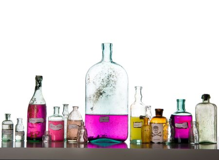 Magic spells. Antique bottles over white background