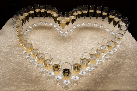 The heart symbol made of champagne glasses photo
