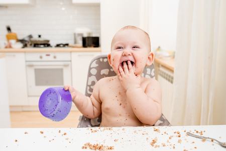 messy eater: Little baby eating. Happy messy eater