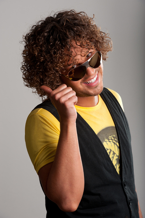 thumbup: Thumbup cheerful young man with beautiful curls
